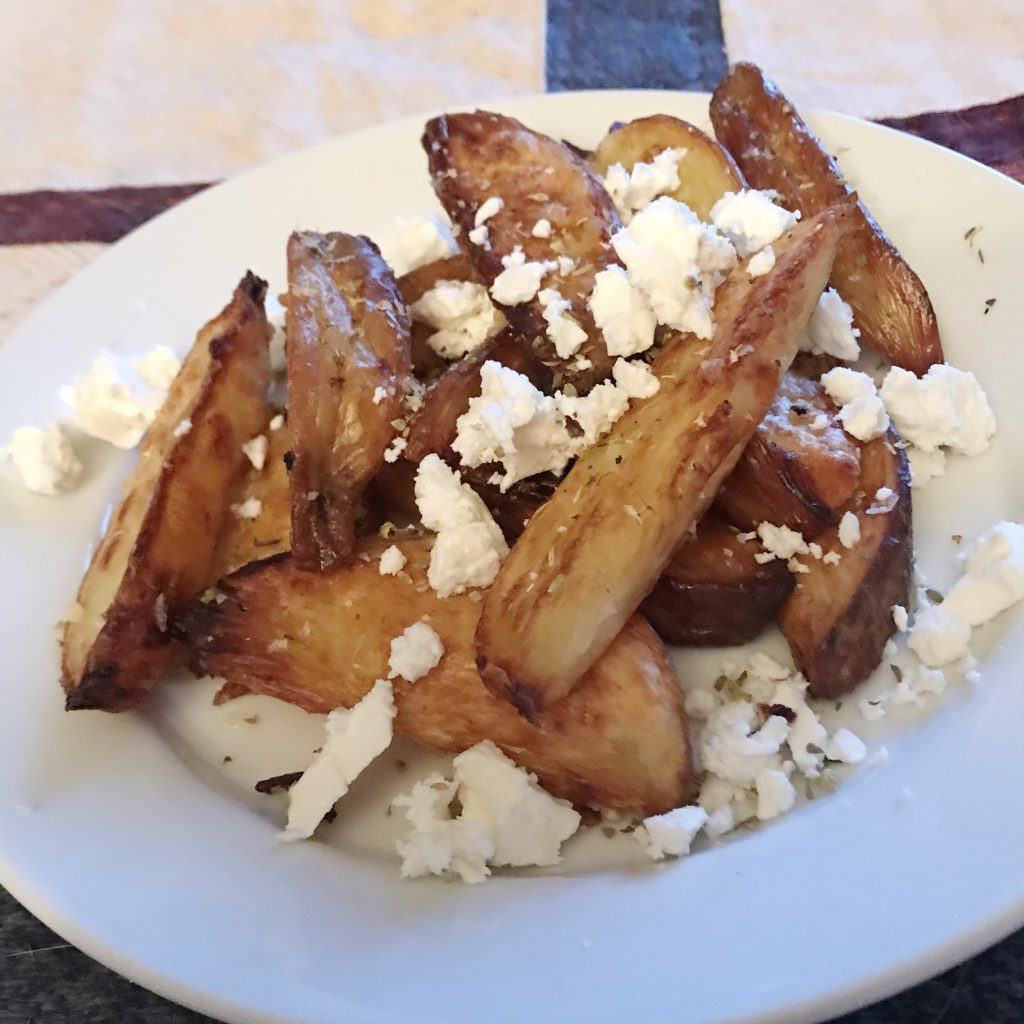 Ottolenghi chips with feta and oregano